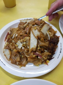 char kway teow (stir-fried flat rice noodles and/or ricecake strips)