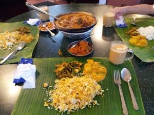 fish head curry with  briyani, pumpkin, chicken tikka masala, potatoes, kashmiri naan, and masala chai tea at Samy's Curry