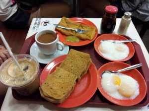 Ya Kun Kaya Toast breakfast set - 2 soft-boiled eggs, kaya toast, french toast, and kopi (coffee)